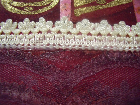 Lace has been attached to the spine for added texture