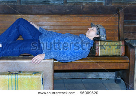 woman-sleeping-on-suitcase