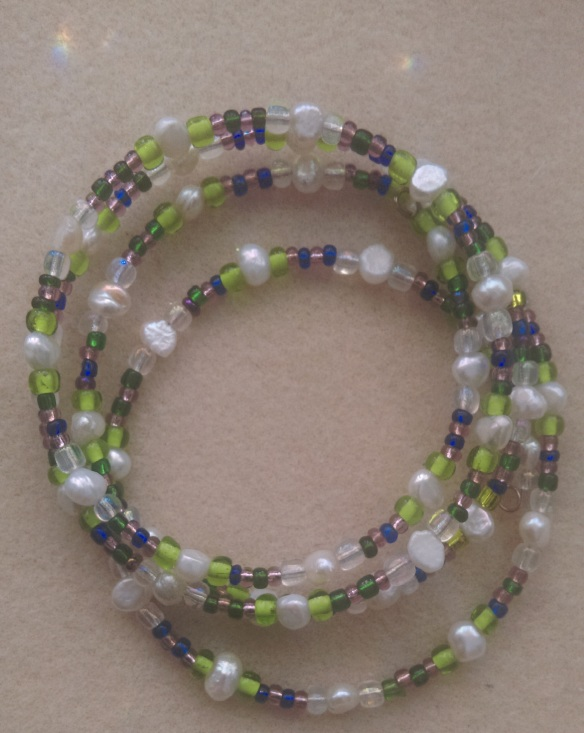 four layered, natural pearls & seed beads.